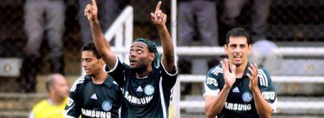 Palmeiras' Cleiton Xavier, Vagner Love and Diego Souza celebrate another win
